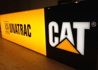 A close up view the illuminated CAT sign