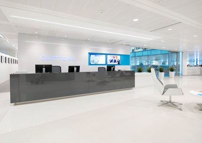 Cluttons modular reception wall system and corian desk