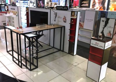 Guerlain MDF laminated POS displays with steel tables