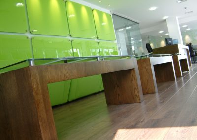 Bespoke veneered tables with glass tops