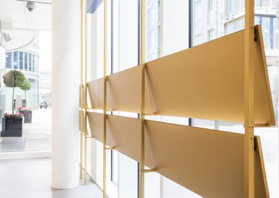 Floor to ceiling mounted brass window displays
