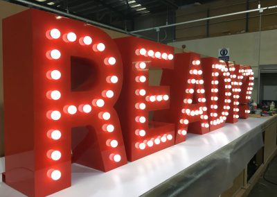 Large built up lettering with bulb illumination