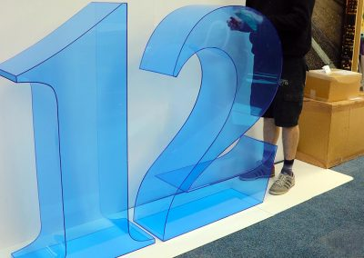Free standing 3d '12' in tinted blue acrylic