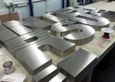 3d stainless steel logo awaiting electrics