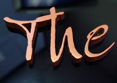 Copper painted acrylic lettering