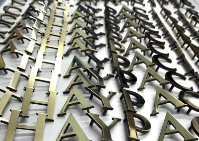 Mirror polished brass letters