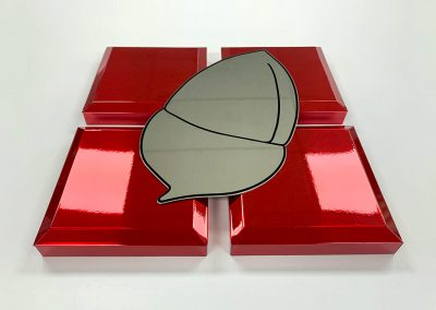 Bevelled edge built-up mirror steel squares with a red tint.